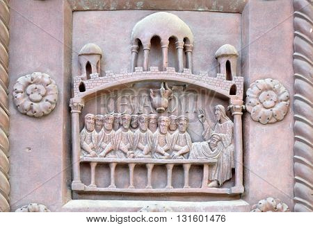 PISA, ITALY - JUNE 06, 2015: The Last Supper on the San Ranieri gate of the Cathedral St. Mary of the Assumption in Pisa, Italy on June 06, 2015