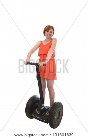 young attractive tourist woman in chic summer dress smiling happy riding electrical segway having fun driving isolated on white background in ecological transport concept