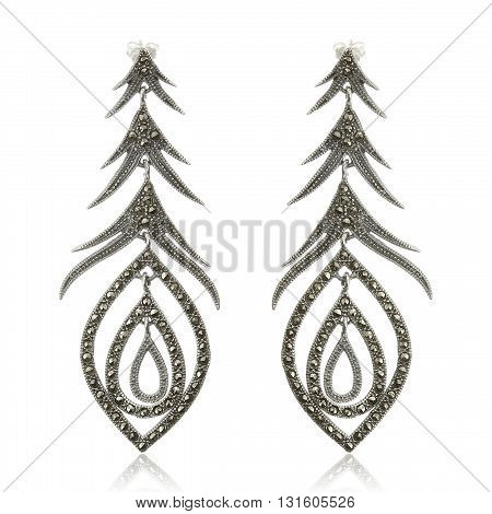 A pair of earrings on white background