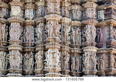 Ancient erotic bas-relief in Khajuraho temple India.