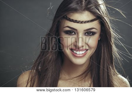 Smiling Woman With Blowing Hair Strands