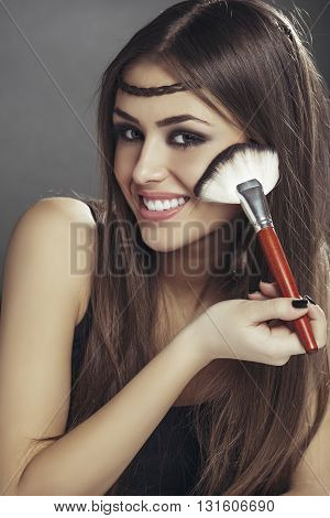 Happy Woman Applying Makeup On Her Face