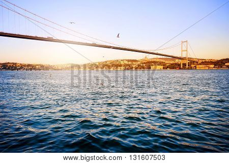 Bosphorus Bridge over the blue water at sunset. Istanbul, Turkey.