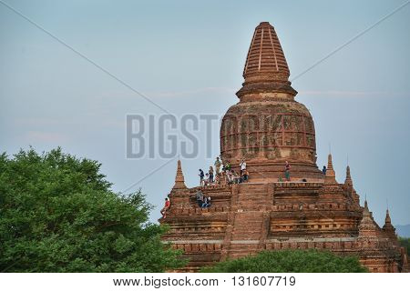 Bagan, Myanmar - April 22, 2016 : Group Of People Looking at Sunrise from Bulethi pagoda