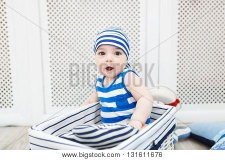 Portrait of the little boy dressed as a sailor