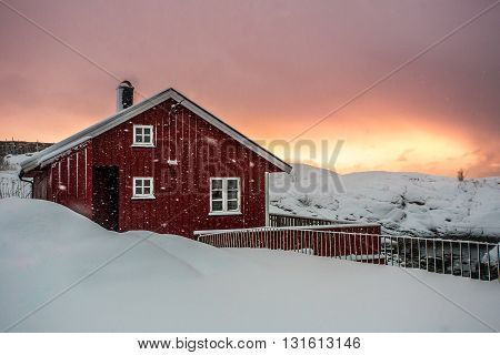 Traditional red fishing rorbu hut on Lofoten islands in Norway