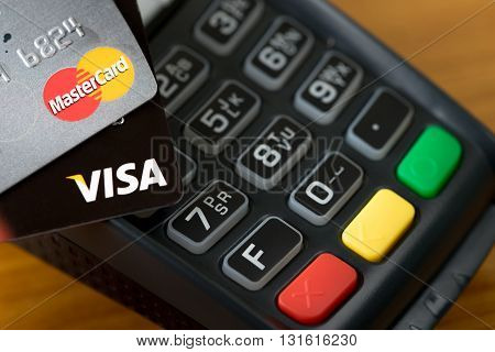 Bangkok Thailand - May 24 2016: Closeup of VISA credit cards on the credit card machine.