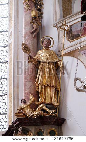 URSBERG, GERMANY - JUNE 09: Statue of saint on the altar in the monastery church of St. John in Ursberg, Germany on June 09, 2015.