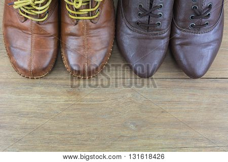Shoes men and women active in daily life./ Shoes on the wooden floor.