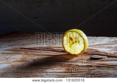 Slice Of Lemon On Wood