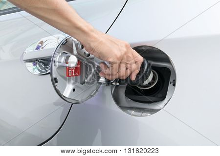 Hand opening the oil filler cap. cap, car, gas, service, hand, oil, f