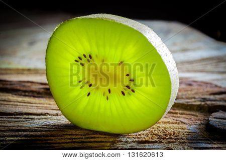 Closeup Of Kiwi Slice On Wood