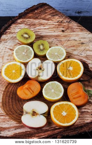 Slices Of Fruits On Freshly Cut Wooden Stump