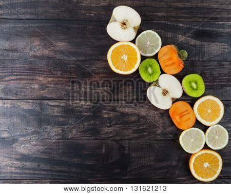 Slices Of Healthy Fruits On Wooden Table With Copy Space