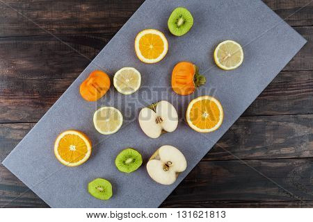 Slices Of Healthy Fruits On Chopping Board With Copy Space