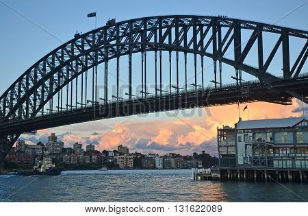 Grand arch of the Sydney Harbour Bridge and ferry
