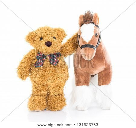 Teddy bear and horses on white background