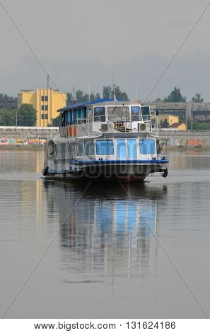 KIEV,UKRAINE - MAY 15, 2016: Pleasure boats on the Dnepr River and river shore in historical area. Kiev. Ukraine