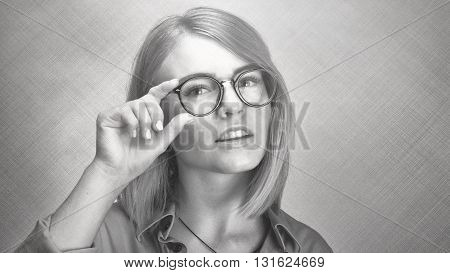 Young Attractive Woman In Round Glasses