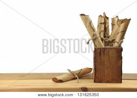 several of old vintage manuscripts in wooden box / isolated on white background /. Past. Information. History. Memory. Secrets. Study.