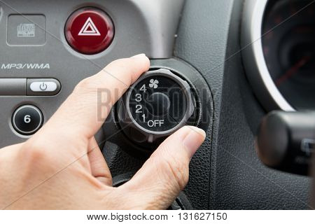 man turning car air conditioner switch. car, air, closeup, cooling, cold,