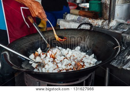 Man is cooking at Kimberly Street Food Night Market in George Town Malaysia.