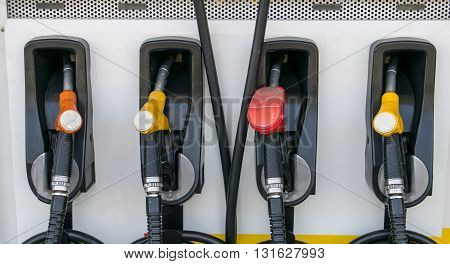 Pump nozzles at the gas station. gas, station, pump, fuel, petrol,