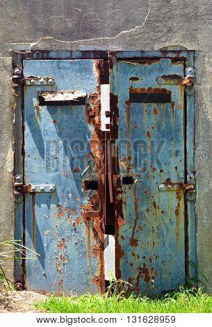 Old, rusty door of an abandoned war bunker