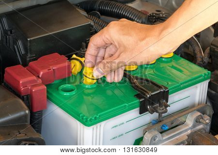 mechanic the battery of a car. car, battery, repair, automotive