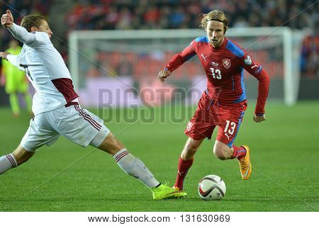 Prague 28/03/2015 _ Kaspars Dubra and Jaroslav Plasil. Match of EURO 2016 qualification group A Czech Republic - Latvia 1:1 (0:1). Goals 90' Pilař - 30' Višnakovs.