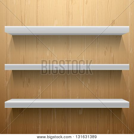 White shelves on wood background with light from the top