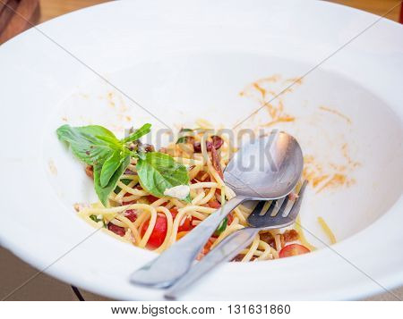 Dirty dish of spicy spaghetti after eatten