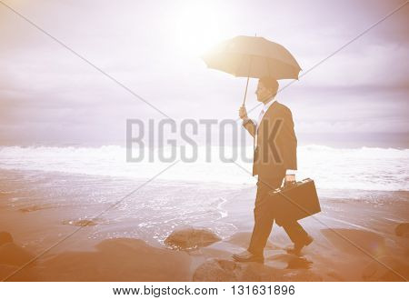 Lonely Businessman Walking by the Beach