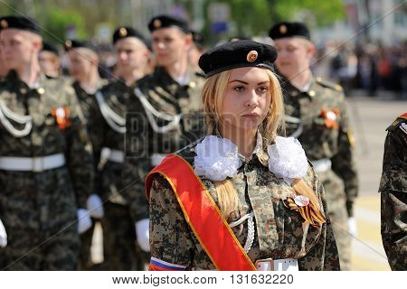 Orel Russia - May 9 2016: Celebration of 71th anniversary of the Victory Day (WWII). Young blond girl military marching