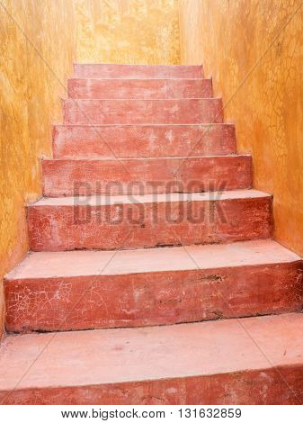 Vintage red cement staircase with yellow cement wall