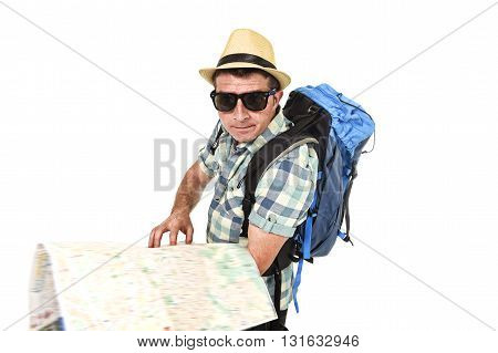 young tourist man reading city map looking lost and confused loosing orientation carrying backpack wearing summer hat and sunglasses disoriented face expression isolated white background