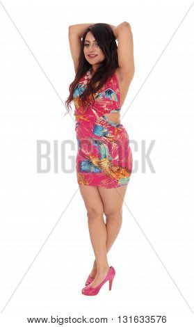 A beautiful young East Indian woman in a lovely dress having her hands on head standing isolated for white background.