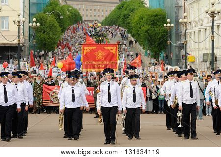 Orel Russia - May 9 2016: Celebration of 71th anniversary of the Victory Day (WWII). Immortal regiment marching with military brass band horizontal