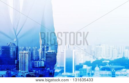 Businessman body in suit on blue city background. Double exposure