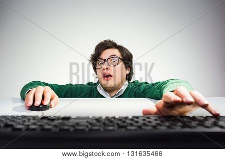 Man Reaching Keyboard