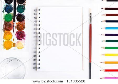 Notepad And Drawing Tools Closeup