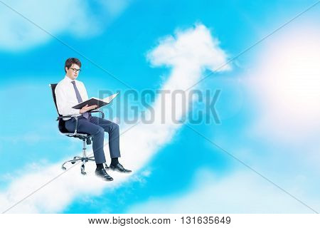 Success concept with businessman sitting and reading on an upward arrow cloud