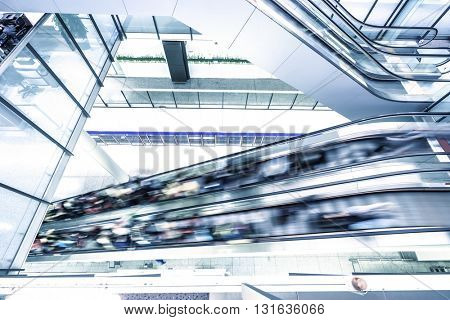 escalator with crowded people in modern building