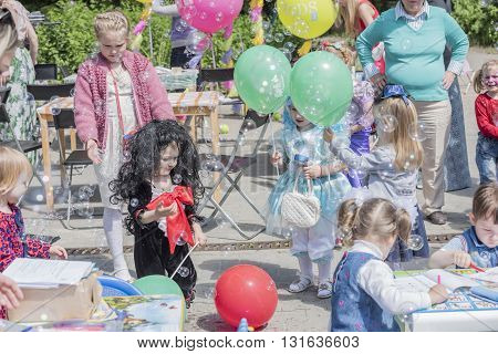 Rostov-on-Don Russia- May 22, 2016: Girls catch soap bubbles on holiday