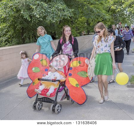 Rostov-on-Don Russia- May 22, 2016: Mothers walking with daughters in carnival costumes