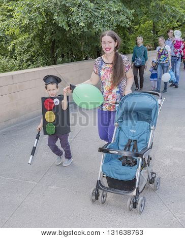 Rostov-on-Don Russia- May 22, 2016: Boy with his mother walks in carnival costume