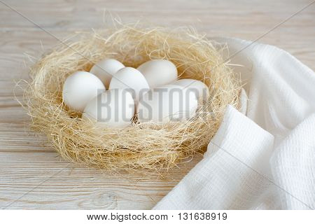 white eggs on a white wooden table