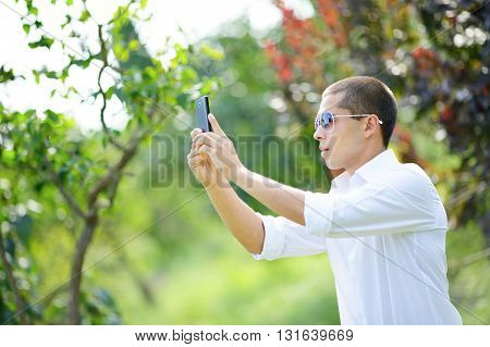 Young Man In Sunglasses Taking Selfie