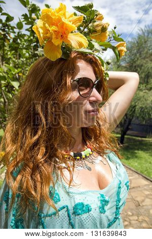 Beautiful brunette in a bathing suit at a tropical garden, Arusha, Tanzania