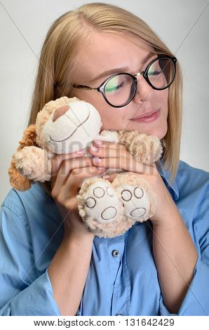 Beautiful Young Woman Hug A Teddy Bear And Smiling
